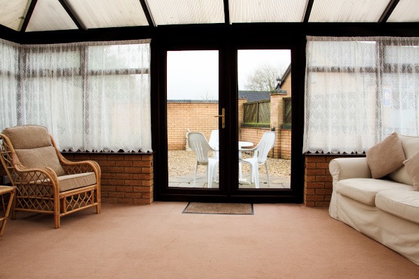 Long Acres holiday cottage conservatory door to garden