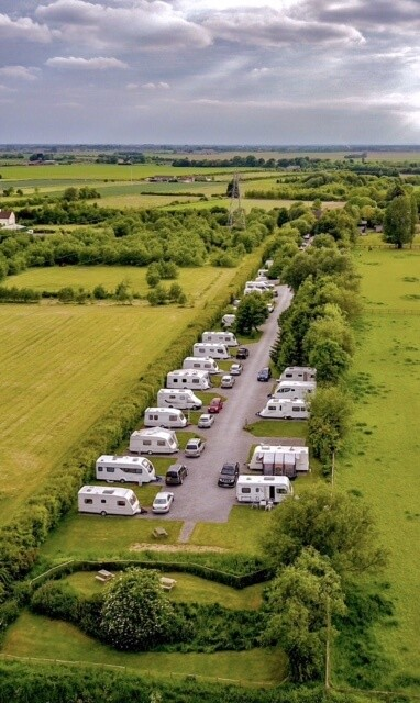 Aerial view of Long Acres Touring Park from rear of park